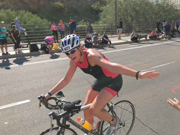 Sherri riding in the 2018 Ironman Triathlon